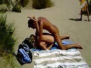 Lucky voyeur films naughty amateurs having beach bang-out