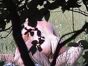 Voyeuristic amateur sex naked couple toying about in a public park